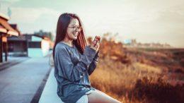 Girl smiling at phone